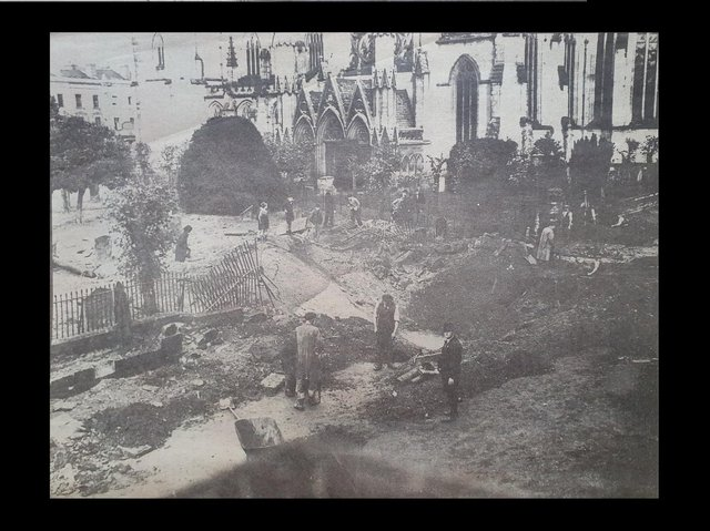 A bomber crater near the parish church, Leamington, October 1940, which caused considerable damage and one fatality.